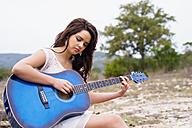 USA, Texas, Teenage girl playing guitar - ABA000765