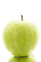 Granny smith with water drops on white background, close up - MAEF005859