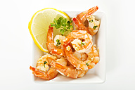 Plate of prawns on white background, close up - MAEF005941