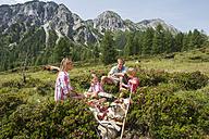 Austria, Salzburg, Family having picnic in mountains - HHF004512