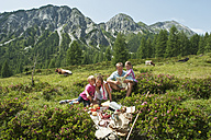 Austria, Salzburg, Family having picnic in mountains - HHF004515