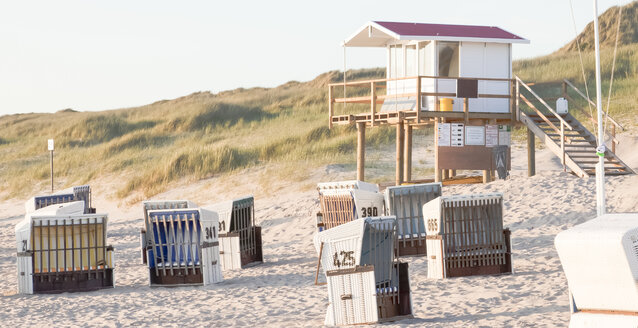 Germany, View of empty beach with roofed wicker beach chairs on Sylt island - ATA000006