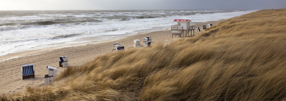 Germany, View of empty beach with roofed wicker beach chairs on Sylt island - ATA000011