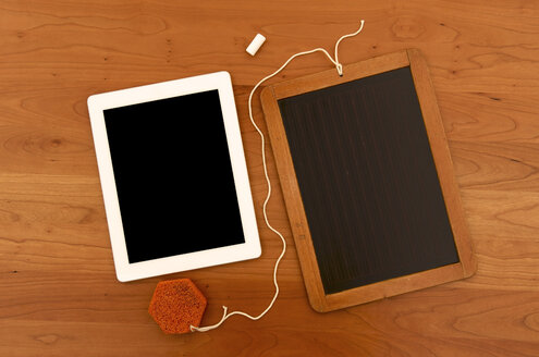 Old chalk board with digital tablet on wooden tablet - JEDF000011
