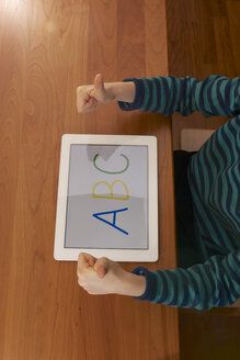Germany, Baden Wuerttemberg, Constance, Boy using digital tablet - JEDF000013
