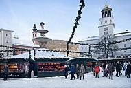 Austria, Salzburg, People at christmas market - WW002689