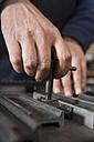 Germany, Bavaria, Man working in print shop - TC003340