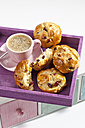 Cranberry scones with cup of coffee on wooden tray, close up - CSF017543
