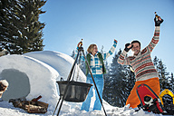 Austria, Salzburg, Couple having fun in front of igloo, smiling - HHF004528