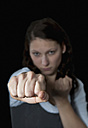 Aggressive young woman fighting with fist, close up - BFRF000189