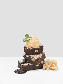 Hazelnut brownies with creme brulee sorbet, chocolate sauce, powdered sugar and physalis - CHF000020