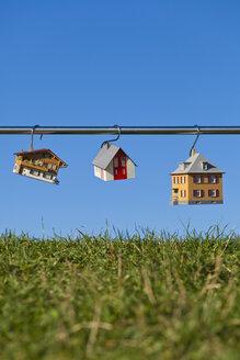 Germany, Baden Wuerttemberg, Stuttgart, House model hanging on steel rod - WDF001604