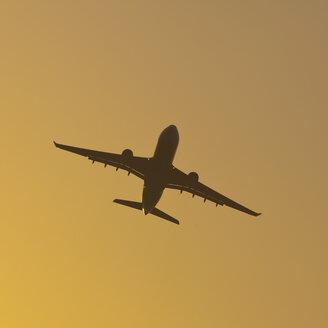Germany, Baden Wuerttemberg, Stuttgart, Aeroplane flying against sky - WDF001609