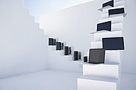 Laptops on white modern stairs - PDYF000369