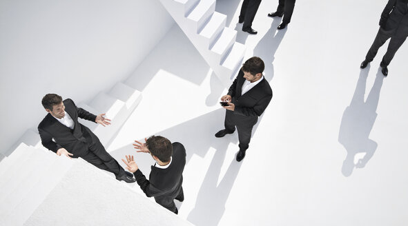 Businessmen doing various activities near stairs - PDYF000439