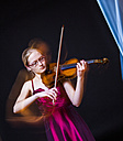 Teenage girl playing violin, close up - DISF000006