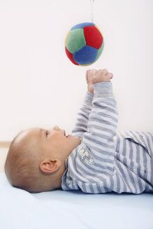 Germany, Bavaria, Baby boy playing with toy, smiling - RDF001092