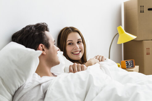 Young couple looking at each other, smiling - SPOF000093