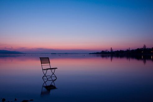 Germany, Baden Wuerttemberg, Chair at lake constance in sunset - BST000002