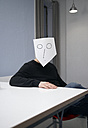 Man covering face with mask - TKF000056
