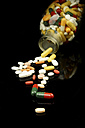 Pouring out pills from bottle - HOHF000090