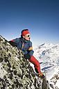 Austria, Man trekking on peak at Salzburger Land - RN001177