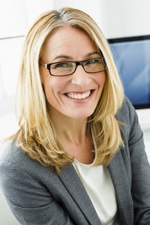 Germany, Portrait of businesswoman, smiling - SPO000145