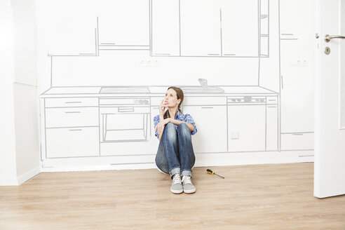 Woman thinking about new kitchen - FMK000510