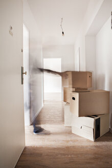 Stack of cardboard boxes in new house - FMKF000532