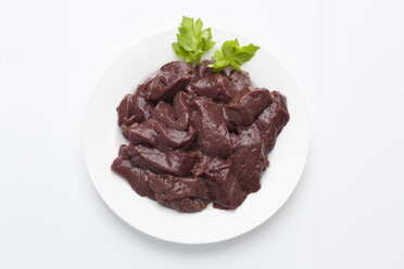 Calf liver pieces in plate on white background - CSF018024