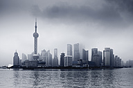 China, Shanghai, Financial District with dramatic sky - FL000309