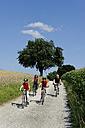 Germany, Bavaria, Cyclist cycling on dirt track - LBF000097