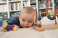 Germany, Hesse, Frankfurt, Baby boy playing with toy - MUF001298