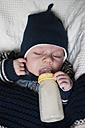 Germany, Hesse, Frankfurt, Baby boy drinking milk, eyes closed - MUF001282