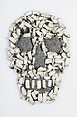 Skull shaped of cigarette stubs on white background - MUF001269