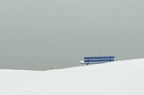 Germany, Baden Wuerttemberg, Constance, View of empty bench in winter - JEDF000021
