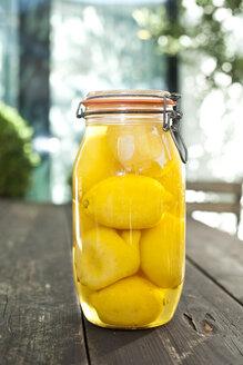 Germany, Duesseldorf, Lemon pickles in glass of jar - KVF000012