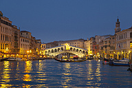 Italy, Venice, View of Grand Canal and Rialto bridge at dusk - HSIF000147