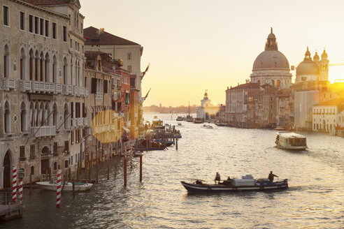 Italy, Venice, Morning traffic on Canal Grande at Santa Maria della Salute church - HSIF000220