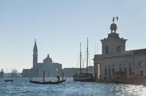 Italy, Venice, Gondolas on Canal Grande at Santa Maria della Salute church - HSI000223