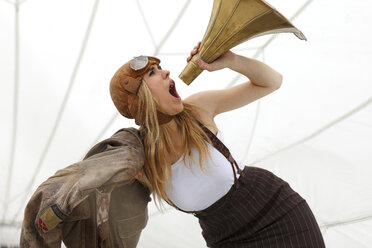 Germany, Paderborn, Woman shouting into Gramophone funnel - AJF000004