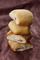Stack of ciabatta rolls on textile, close up - CSF018304