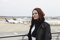 Germany, Cologne,  Young woman at airport - RHYF000321