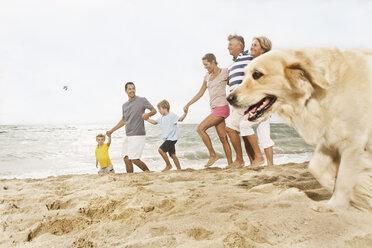 Spain, Family walking on beach at Palma de Mallorca - SKF001206