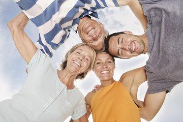 Spain, Portrait of family on beach at Palma de Mallorca, smiling - SKF001177