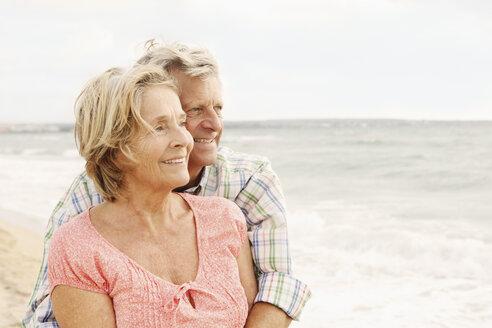 Spain, Senior couple embracing on beach at Palma de Mallorca - SKF001185