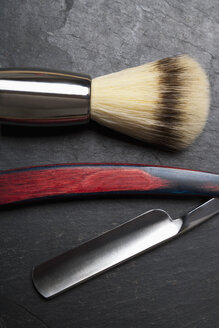 Shaving brush and razor on slate board, close up - TDF000040