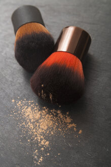 Make up brushes and make up powder on slate board, close up - TDF000004