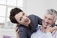 Germany, Bavaria, Munich, Couple having fun at home, smiling - RBF001279