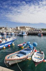 Spain, View of fishing harbour and Castillo Guzman El Bueno - WW002860